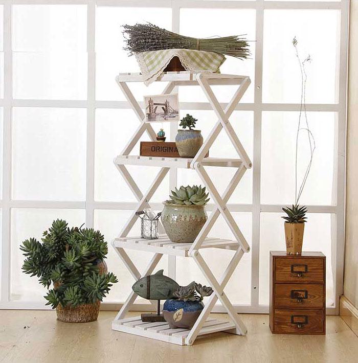 Kệ sách thông minh bằng gỗ giá rẻ, kệ sách có thể xếp gọn, kéo thẳng đứng hoặc lằm ngang đều được.